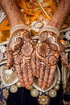 """TWIRLS SWIRLS AND WHIRLS The intricate mehendi designs are implicitly and immaculately traditional! Can anything else be a better symbol of expression of the depths of love. Brides have all kinds of tensions, """" Will the clothes fit ?!,"""" """"Will the colour of the mehendi be deep?"""" and oh yes- sarees? But Shatika has a one stop solution for shopping for sarees for the brides of this season. Buy sarees online. Indulge in our latest Shatika Banarsi soft silk sarees collection."""