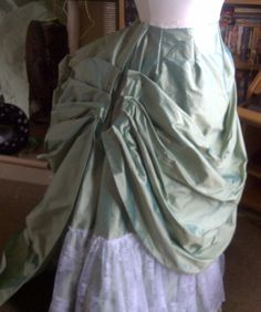 Natural form Victorian skirt: Prepare the apron front and train. Start with arranging the side pleats on the apron and the train. Sew the two parts together at the sides, and insert the waistband.