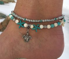 This pretty double strand beach anklet is made with a silver plated metal turtle charm, turquoise and white starfish, turquoise and white howlite beads, silver Tibetan beads, and silver glass beads. Beach anklet measures 10 inches and closes with a silver lobster clasp. Not your size? No problem! Just message me and Ill be happy to make your size for you