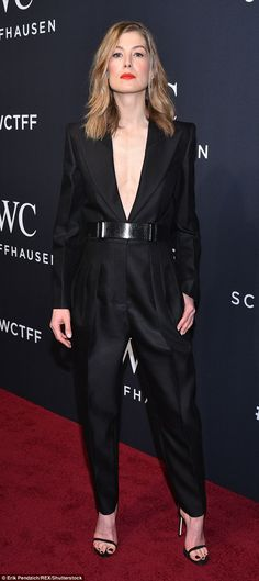 Stunner: English actress Rosamund Pike chose a tailored black jumpsuit with a jacket-style bodice slashed to the waist