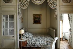 Château de La Motte-Tilly, chambre Vindé - Featuring: Recessed Wall Alcove for Bed; flanking Glass-Paned Doors; Wall Panelling Detail around doors & within alcove; Bedside Table with Lamp - mid 18th Century. [source: www.Regards.Monuments-Nationaux.fr; Portfolio Collection of Regional Monuments]