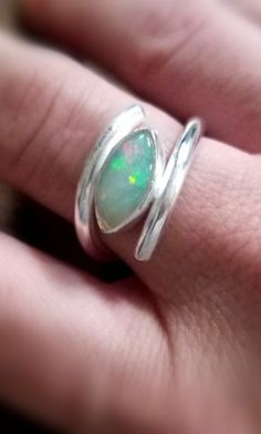 Opal, what a beautiful stone! It has the colors of every other stone and depending on the way you look at it, its always different! This ring is made with a thick gauge of sterling silver. The opal is a a marquise cut, AAA quality Translucent to semitranslucent, with play-of-color against a white or light blue background. This is a solid natural opal not a doublet or triplet that are on the market often today.  October Birthstone  Ready to ship  The size of the stone is 12.3 x 6.2 mm and it…