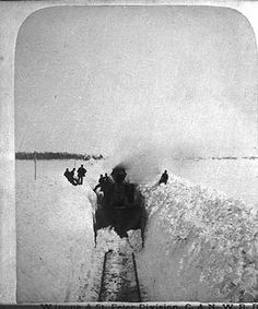 """A Chicago and North Western Railway """"woodburner"""" pulling out  of Sleepy Eye, MN after the great blizzard. 3/22/1881"""