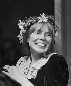 Joni Mitchell--very young, completely natural, and (more than likely) madly in love.  It's the smile.