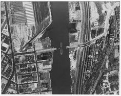 . Aerial view of bridge showing ramp down to Landing Street in the Bronx (East) and railroad yard in Manhattan (West). (New York State Department of Transportation; Photographer unknown; View taken in approximately 1986) - University Heights Bridge, Spanning Harlem River at 207th Street & West Harlem Road, New York County, NY