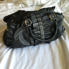 Aldo black leather-like bag Black fake leather purse. In very good condition! Ruffle and gold stud detailing on front. Inside fabric is a little faded (as shown in picture #3) and handles have a few cracks (as shown in picture #4), but neither one takes away from the look of the purse. ALDO Bags Hobos