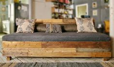 looks like reclaimed wood... maybe pallets... what a beautiful couch!    LOVE! don't have source so leave a note if you have it.