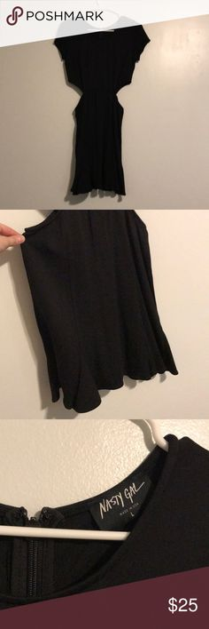 Black side cut out dress Black textured scuba-like material. Easygoing sleeves on top and flippy skirt on the bottom. Hidden zipper in back. This is a large but it runs small in my opinion, I would normally be a medium or even a small. Open to offers Nasty Gal Dresses Mini