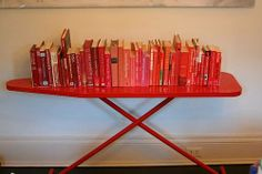 Looking for cheap DIY bookshelf or book display ideas? Find out how to build functional, inexpensive, DIY bookshelves for your home. Old Ironing Boards, Iron Board, Red Books, Mobile Bar, Organization Hacks, Reuse, A Table, Repurposed, Shabby Chic