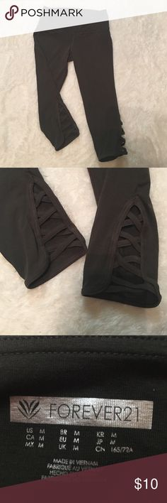 Criss Cross Cut Out Activewear Capri Leggings Forest green Capri length activewear leggings. Features criss cross cutout on the bottom. Thick waistband for a flattering look. Worn twice! Forever 21 Pants Leggings