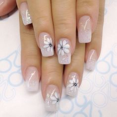 Give more focus on your flower design and keep it as realistic as possible. Then keep the base a pink-base clear nail polish with little glitters.