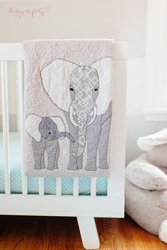 This elephant quilt in a modern nursery is fantastic!