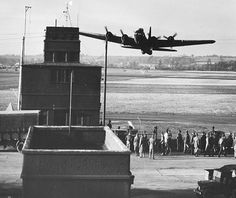 Memphis Belle, buzzes the control tower at Bassingbourn, 91st BG