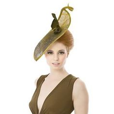This ombre olive hand cut teardrop with finishing wisp is studded with peacock toned Swarovski crystals and thermoplactic bow detail.  #ss16 #milliner #millinery #farnham #fashion #fascinator #hat #hatshop #handcrafted #london #nature #robinhood #thermoplastic #swarovski #royalascot #londonfashion #fashiontrend #fashionstylist