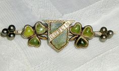 """Victorian era 800 silver brooch or bar pin, 2"""" x 1/2"""" (53mm x15mm) inlaid with green Connemara marble. The pin dates from about 1890 - 1900 . These old pins were inspired by the Irish Nationalist Movement, which began in the 1880's as a reaction to English influence and the perceived loss of Irish cultural identity.  The pins often included Irish symbols,the harp or shamrock, and included native Irish materials,such as Connemara marble or bog oak."""