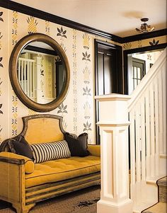 This is a revelation of brightness, proportion, and balance.  The stenciled wall covering sets the tone subtly and the rest of the room responds respectfully.  It would make me happy to walk into this entry every day!