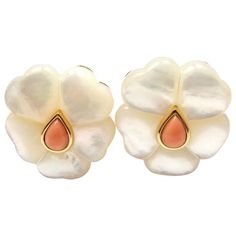 Van Cleef & Arpels Mother of Pearl Coral Flower Clip Earrings. 18k yellow gold mother of pearl, coral clip earrings from Van Cleef & Arpels Flower collection. These earrings are clips made for non pierced ears, but can be converted for pierced ears. With 10 heart shaped mother of pearl stones and 2 pear shaped coral stones