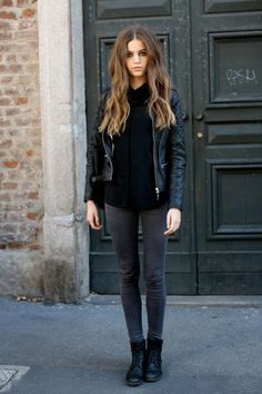 Black blouse, black leather jacket, black boots and jeans
