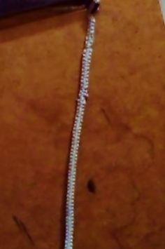 bracelet, hemp core with double width outside of silver/blue string