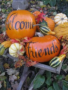 """Cart full of welcome! paint or write with Sharpie - 'Welcome Friends"""" on pumpkins - arrange in wagon with gourds and fall foliage!"""