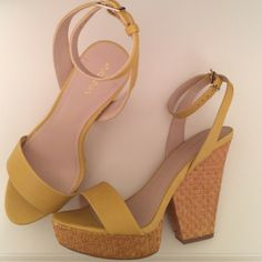 Mustard yellow platform heels Fun and flirty! Worn once indoors. Chunky heel and platform for comfort. Natural woven bottoms. Adjustable ankle strap. More photos available. Just ask! Xhilaration Shoes Heels