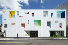 The Sugamo Shinkin Bank Tokiwadai Branch by Emmanuelle Moureaux features a white, aluminium facade punctured by holes that form the shape of a series of trees Architecture Du Japon, Architecture Design, Facade Design, Contemporary Architecture, House Design, Colourful Buildings, Kindergarten Design, Japan Design, Japanese Architecture