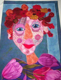 Portret, dit portret is gemaakt van textiel (2) en in 2D. Voor het portret zijn verschillende soorten stof gebruikt die op elkaar genaaid zijn.