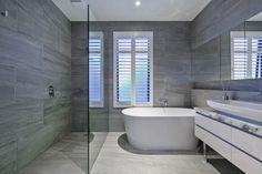 Level two: Ensuite bathroom.  Pale grey Italian porcelain tiles ( 450x900 mm ) and Arasbescato Marble vanity.