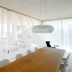 Image 17 of 24 from gallery of Jellyfish House / Wiel Arets Architects. Photograph by Jan Bitter Jellyfish, Chandelier, Ceiling Lights, Curtains, Bitter, Gallery, Interior, Architects, Milk