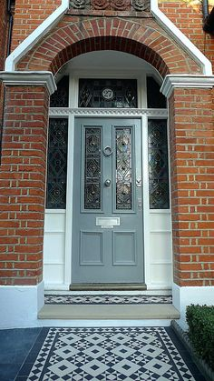 Front Door Brick House Victorian Black And White Mosaic Tile Path Battersea York Stone Rope Edge Buxus London Front Garden Front Door Stepshouse Front Door Paint Colors Red Brick House Navy Front Door Front Door Steps, Front Door Porch, Front Door Entrance, House Front Door, House Doors, Up House, House Entrance, Front Path, Front Entry