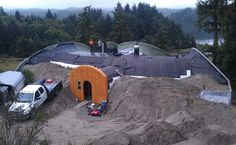An earth sheltered home in Oregon being readied for its earth covering. A whole blog devoted to the construction of this home here: dragonflyhill.org
