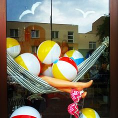 Window display with hammock- Relax these solutions make organising easy.