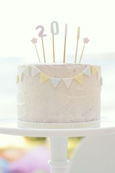 simple cake - so adorable, tiered with the little banners would be so darling