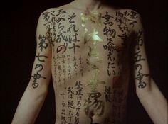Wow. Amazing, cursive-style Japanese writing tattoo. Gorgeous.