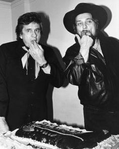 Johnny Cash and Waylon Jennings gettin' a little sugar of the refined variety.