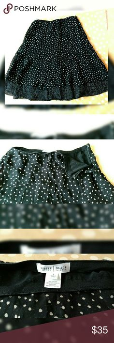 """White House Black Market Skirt A-line black and cream spotted skirt from White House Black Market. It has a zipper on the side with multiple layers. Material is 100% silk and the length is 23"""". Super cute! White House Black Market Skirts A-Line or Full"""