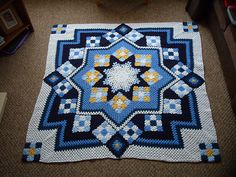 This is amazing: the stars, the stained glass look..... It's EviesMummy's Blue star afghan based on the Blue Star pattern here: http://www.ravelry.com/patterns/library/blue-star
