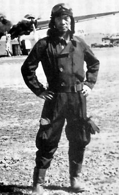 A great photo of famous JNAF ace Saburō Sakai of the Tainan Air Group, most likely taken sometime before his serious wounds on August 8th, 1942. Note the G3M bomber in the background.