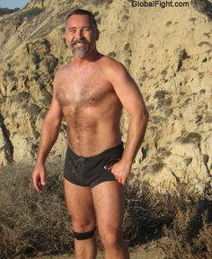 a hiking man gym shorts bulge stomach hairychest
