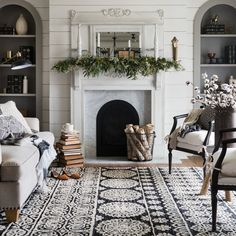 Like the mix of the strong rug with the muted furniture and the marble fireplace.