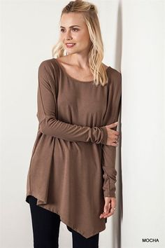 Number One Best Seller Of All Items! Asymetrical Long Sleeve Top. Runs a bit big.