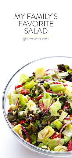 Our Family's Favorite Salad is made with lots of artichoke hearts, roasted red peppers, toasted pine nuts, and a zesty Parmesan vinaigrette. SO delicious, and always a crowd pleaser! | gimmesomeoven.com Kinds Of Salad, Artichoke Hearts, Roasted Red Peppers, Fruits And Veggies, Cobb Salad, Pasta Salad, Vinaigrette, Parmesan, Crab Pasta Salad