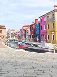 Burano Island in the Venetian lagoon , historical home of local lace making and of effortless picturesque postcard scenes : travel
