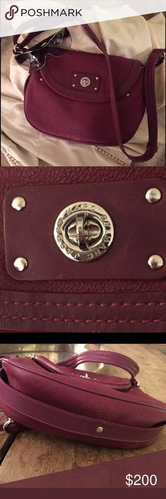 Marc  by Marc Jacobs crossbody bag. Marc by Marc Jacobs limited edition deep rich burgundy leather crossbody bag w/fold over zip-around. Pebbled leather with silver hardware.  Adjustable strap.  Hidden magnetic closure. Inside has 2 large pockets- one with zip closure.  Excellent condition. Like new. Marc by Marc Jacobs Bags Crossbody Bags