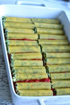 Delicious baked spinach and ricotta cannelloni in tomato sauce. Soft egg pasta filled with creamy ricotta. Spinach Cannelloni, Cannelloni Recipes, Manicotti Recipe, Spinach Ricotta, Spinach Recipes, Veg Recipes, Italian Recipes, Pasta Recipes, Vegetarian Recipes