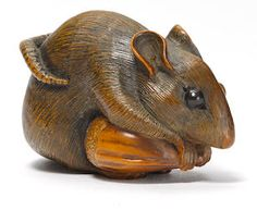 A wood netsuke of a rat with a chestnut By Mitani Goho, Iwami, Edo period (19th century)