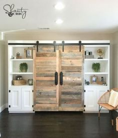 Free Plans and tutorial to create an amazing DIY Sliding Barn Door Hidden Desk System. Perfect home office piece! Detailed instructions and photos! - August 03 2019 at Diy Barn Door Plans, Diy Sliding Barn Door, Diy Door, Living Room Sliding Doors, Room Doors, Basement Storage Shelves, Wall Storage, Wood Shelves, Kitchen Storage