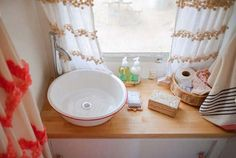 Even though I don't care for vessel sinks, this is a nice use of space and very cozy looking. Airstream interior decor f