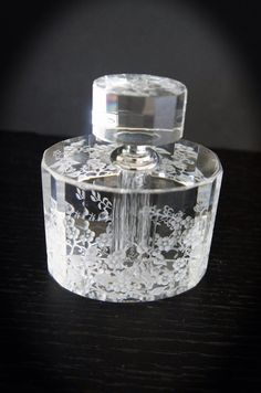 Sensation galore, crystal perfume bottle hand engraved on Etsy, $155.00