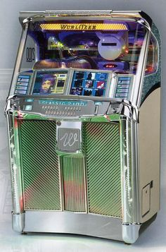 This classic Wurlitzer Jukebox at auction for $1,100. Description from pinterest.com. I searched for this on bing.com/images